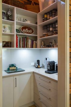 A stunning, mid-century inspired kitchen to suit the 1970s built home. www.thekitchendesigncentre.com.au @thekitchen_designcentre Cookbook Storage, Overhead Storage, Pantry Ideas, Bathroom Medicine Cabinet, Liquor Cabinet, 1970s, Kitchen Design, Mid Century, Interiors