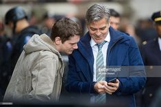 News Photo : Actors Jack O'Connell and George Clooney seen...