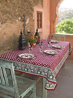 Love this rustic terrace, great tablecloth