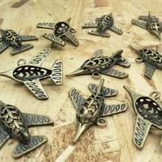 Fantastic fighter plane charms....  You will receive 10 pieces.  These charms are made from a zinc alloy metal which is lead and nickel free.