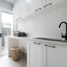 SPLASHBACK A white textured overlay to bring the hamptons to life in the laundry. Also admire the matte black tapware and handles for a a bold yet beautiful contrast. Laundry Room Tile, Laundry Nook, Room Tiles, Small Laundry, Laundry Cupboard, Laundry Cabinets, Laundry Baskets, Cupboard Handles, Cupboard Doors