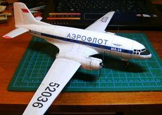 This airplane paper model is a detailed Aeroflot Ilyushin (NATO reporting name: Crate), a Soviet twin-engine commercial and military personnel and ca Paper Airplane Models, Model Airplanes, Paper Models, Paper Planes, Origami Plane, Airplane Crafts, Paper Magic, Military Personnel, Paper Houses