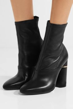Heel measures approximately 105mm/ 4 inches Black leather Zip fastening along back Made in Italy