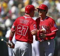 Semien's game-ending single in 11th lifts A's over Angels   -   Los Angeles Angels' Shohei Ohtani, right, is congratulated by Mike Trout (27) at the end of the second inning of a baseball game against the Oakland Athletics on Thursday, March 29, 2018 in Oakland, Calif. (AP Photo/Ben Margot)
