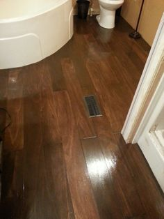 Plywood plank floor stained with General Finishes Antique Walnut.
