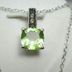 "ColoreSG Sterling Silver 14k Gold Peridot Necklace Designer Authentic ColoreSG by LORENZO 925 Sterling Silver & 14k White Gold, Peridot & Smoky Quartz Necklace   Brand: ColoreSG by LORENZO  Color: Silver and Green Condition: New in Gift Box ( no tags ) with Certificate of authenticity  Item Type: Necklace Total Weight: 2.0 Grams Material: 925 Sterling Silver & 14k White Gold Overlay Gemstones: 1.5ct Peridot  Measurements/Size: Chain: 18"". Pendant: 1/2"" long ColoreSG by LORENZO Jewelry…"