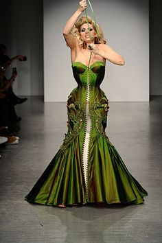 """A quick-release corset-dress. A single flat steel bone is inserted between those alternating short loops of material - pulling out the bone causes the whole outfit to immediately """"unzip""""."""