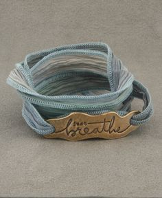 Inspirational wrap bracelet made of reclaimed bronze and hand dyed silk wrap. Made in the USA - inspirational jewelry available at Buddha Groove.