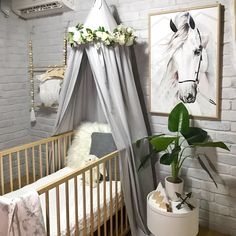 The Avery crib / cot canopy in grey creates the most welcoming, peaceful and serene space in your baby's nursery. A statement piece of nursery decor, enclosing your little baby in their cot, crib or bed away from the busy world for a sweet slumber or decor in an older kids bedroom as a quiet reading nook. I love that the canopy can grow with your child adapting to an array of uses. White peony wreath available online also.