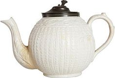 1880s English cream salt-glazed teapot with decorative embossed pattern and attached pewter lid.