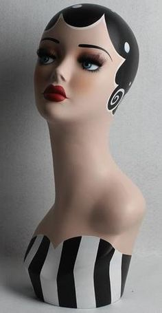 Love the Polka Dots and curls!Vintage hand-painted mannequin head