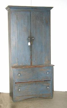 An American blue painted pine step back cupboard