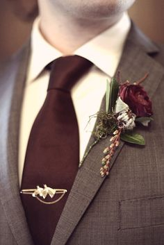 Very chic wine/burgundy groom attire! Perfect for winter.