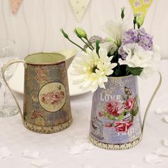 Vintage Jugs Imagine these gorgeous vintage-style jugs overflowing with handpicked flowers, proudly lining your reception tables. Their great floral patterns and worn look give the feeling of a treasured jug which has been kept in the family for many years. If you're going to DIY your wedding flowers, this would be the perfect way to finish them off