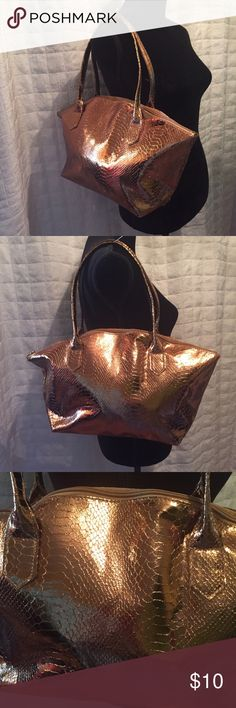 "Metallic bronze/copper bag NWOT Over night or anything bag  NWOT and a beautiful metallic bronze copper color. Zipper top with no pockets. This is not the highest quality bag but is really awesome for storage, overnight, make up etc. no name, measures, 17 inches of crossed 9.5 inches high with 7 inch double drop straps bottom measures 3.5 x 11"" Bags Travel Bags"