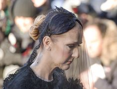 Celine wore a full-sleeve black dress and a full black veil to the service in honor of her...