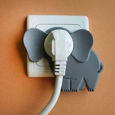 You've seen the nose plug. Here, now, the elephant plug. (via Bem Legaus!: Elefantinho de tomada)
