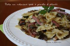 Pasta con melanzane speck e granella di pistacchi