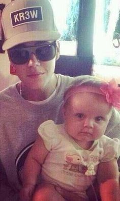 Justin is so cute with babies
