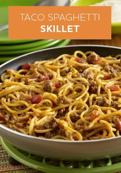 Taco Spaghetti Skillet -- Transform your spaghetti into taco night! This Pot-Sized Pasta recipe uses ground beef, zesty tomatoes, and spaghetti. Top with sour cream for one delicious dinner!