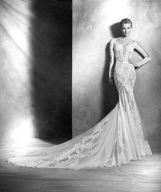 either pronovias ($1,500-$3,500) or atelier pronovias ($3,500-$12,000) @ dimitra's bridal couture chicago.