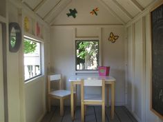 Grandkid's playhouse - Ana white's design but I love the interior details.   Chalk board. Fun decals. Little table. Outside windowbox.