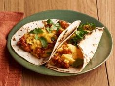 Egg and Chorizo (No. 33) : Brown 1/4 pound crumbled fresh chorizo in a skillet. Add 6 beaten eggs and cook until just set. Serve in tortillas with cilantro.