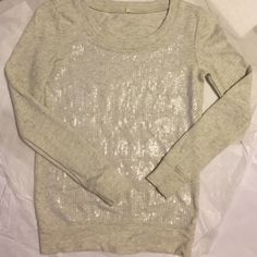 J Crew sequin Top! J Crew heather gray top with clear sequin all over the front! Super great with jeans or to dress up! Great color goes with everything! Gently worn a few times overall good condition! J. Crew Tops