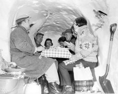 """Four adventurous couples dined in a snow house they carved in the middle of a giant drift in February 1960. They had charcoal-broiled steak, salad and vegetables. Mulled wine and a lantern provided warmth. Dessert was blueberry sauce poured over snow squares cut from the ceiling. The """"dining room"""" was dug out of a snowdrift along Nebraska Highway 36 just east of Bennington. THE WORLD-HERALD"""
