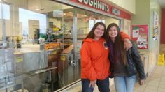 Anna and Sara gettin' some yummy doughnuts