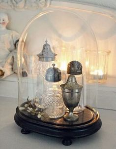 Lovely sugar shakers under a cloche. Could use pretty salt shakers as well. Cloche Decor, The Bell Jar, Bell Jars, Deco Restaurant, Vibeke Design, Apothecary Jars, Mason Jars, Glass Domes, Glass Dome Display