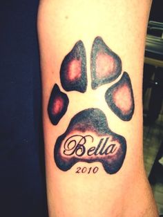 """My sister in law was just recently telling me what she had in mind for her next tattoo... how is it that I just stumbled upon THIS paw print (as she wants her American Bull-Dog's) with """"Bella"""" printed in it AND her dogs name is BELLA!! Too cute!! This ones for u Roo <3"""