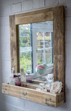 Pallet Ideas Pallet Wood Mirror Frame with Storage - Reclaimed wood, galvanized metal, rough stone and cast iron are all part of rustic bathroom decor ideas. See the best designs and try them at home! Rustic Bathroom Mirrors, Bathroom Mirror With Shelf, Rustic Bathroom Designs, Wood Framed Mirror, Bathroom Ideas, Pallet Bathroom, Diy Mirror, Mirror Vanity, Vanity Decor