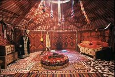 In Almaty, Kazakhstan, brightly colored carpets adorn the floor and interior walls of a yurt, a domed tent used by nomads. Yurt Interior, Interior Walls, Interior Design, Mongolian Yurt, Bedouin Tent, Yurt Living, Living Room, Yurt Home, Bell Tent