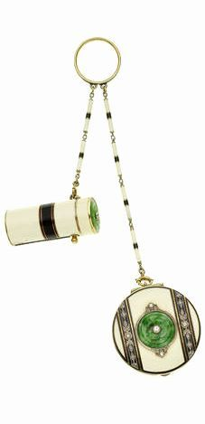 An enamel, jade and diamond lipstick and compact, circa 1925 The black and cream enamel lipstick and circular compact, the lids decorated with carved jade flowerheads and millegrain-set old brilliant-cut diamonds, each suspended from a black and cream enamel baton-link chain, to a black enamel suspension ring, jade untested, ring size O½, fitted case (illustrated above)