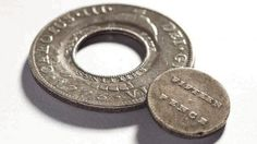 'holey dollar and 'dump - these coins were used in Australia from about 1813 to about 1822. Due to a shortage of coins in the new colonies, Governor Macquarie ordered £10,000 in Spanish dollars to have their centers punched out and then circulated as two coins - the outside 'washer' shaped coin, known as a 'holey dollar' and the plug punched from its center as another coin known as a 'dump'. Of the 40,000 coins in circulation all but about 350 'Holey Dollars' and about 1500 'Dumps' remain.