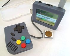 Thingiverse member tiny retro games console: a Raspberry Pi-powered Pi Boy Classic High End Gaming Pc, Portable Console, Gaming Pc Build, Mini Arcade, Raspberry Pi Projects, Video Game Console, Cool Things To Buy, Gadgets, Prints