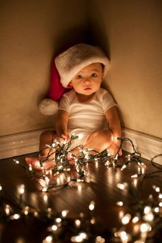 Baby in the corner Baby's first Christmas with Christmas Lights family photo