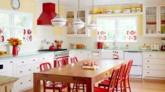 If you don't want to dish out the cash on a retro fridge or oven, add splashes of color throughout the room. Here, the yellow paint job instantly makes the room more upbeat, and the classic red hue makes an appearance on the cabinet knobs, chairs and hood.