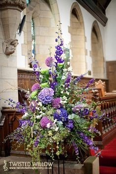 Classic church pedestal in gorgeous summer blues and purples #flowers #centrepiece