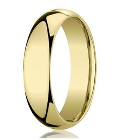 This Designer Gold ring is designed with a slight domed face and a comfort-fit design on the inside. The comfort-fit design on the inside is curved so that less ring is touching the finger. This design is considered the traditional plain wedding band. This ring is 7 mm in width and made from 10K yellow gold with a polished finish. Web Page:  http://www.justmensrings.com/Designer-7-mm-Domed-Comfort-fit-10K-Yellow-Gold-Wedding-Band--JB1005_p_18.html