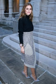 Elegant: Olivia Palermo looked effortlessly stylish with her hair left tousled and a huge gem stone bracelet