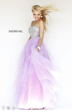Sherri Hill 11085 is a Sadie Robertson Live Original!!! Dazzle your friends in this form fitting strapless gown. The intricate design work of beading of the bodice adds a unique touch to such a beautiful gown. This dress is fitted with a fuller tulle skirt that we absolutely love! Sherri Hill 11085 will look great on any body type and will be sure to WOW at your next event!
