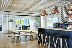 office interior by idstudio  coffeebar and meeting area  table and benches a John Pawson design for Viccarbe