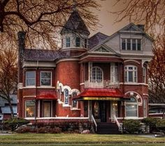 Love the windows along the tower on this Victorian house.