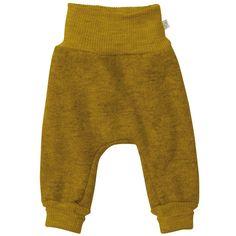 Pantalonii lejeri Disana sunt creați pentru bebeluși și copii astfel încât să poată explora mediul înconjurător.  Pantalonii sunt prevăzuți cu un brâu înalt și lejer în talie  care va păstra spatele și burtica copilului la căldură. Croiul mare lasă suficient spațiu pentru scutec și pentru straturile de dedesubt care conferă micului explorator libertate de miscare.  Lâna fiartă de  la Disana este creată pentru a fi călduroasă și rezistentă, dar în același timp moale.   Mărimi: 62/68-98/104. Cuffed Pants, Harem Pants, Trousers, Natural Stain Remover, Baby Pants, Merino Wool, Organic Cotton, Sweatpants, Pure Products