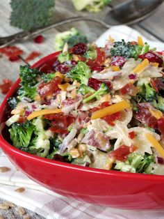 Broccoli Cranberry Pasta Salad:  With bow-tie pasta, broccoli, prosciutto, cranberries, sunflower seeds, red onion...:)
