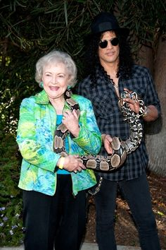 Betty White and Slash pose with Jacob, a Columbia Red Tail Boa Constrictor at the 2011 GLAZA Beastly Ball at the Los Angeles Zoo on June 18th, 2011.