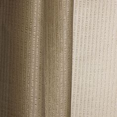 TATAMI col. 003 by Dedar - A washable and fire-retardant jacquard sheer yarn-dyed in 4 natural colours. Slight variations in the weave tension and contrasting tones between the warp and weft come into play to create luminous and relief effects, while the hang of this fabric is soft and full.