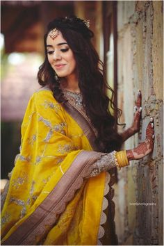 Looking for A bride in a yellow lehenga for her wedding? Browse of latest bridal photos, lehenga & jewelry designs, decor ideas, etc. on WedMeGood Gallery. Indian Photoshoot, Bridal Photoshoot, Bride Poses, Wedding Poses, Wedding Shoot, Wedding Couples, Wedding Ideas, Girl Photo Poses, Girl Poses